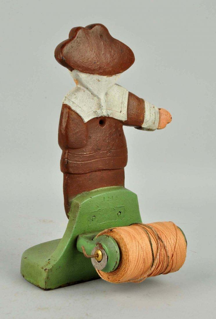 Cast Iron Pilgrim Boy Figural Stringholder. - 2