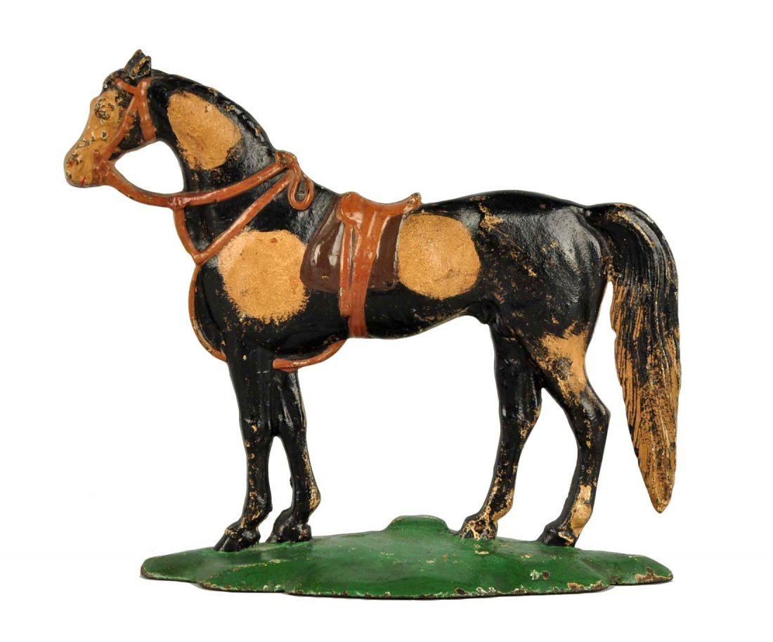 Cast Iron Saddle Horse Doorstop.