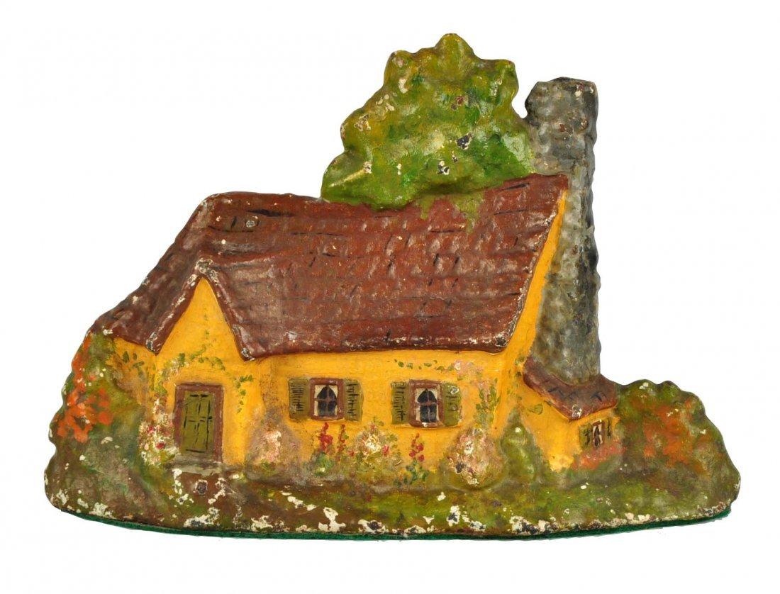 Cast Iron Cottage Doorstop.