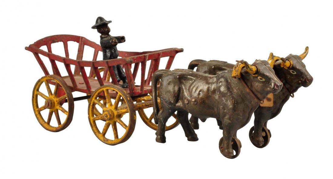 Kenton Cast Iron Oxen Drawn Cart Toy.