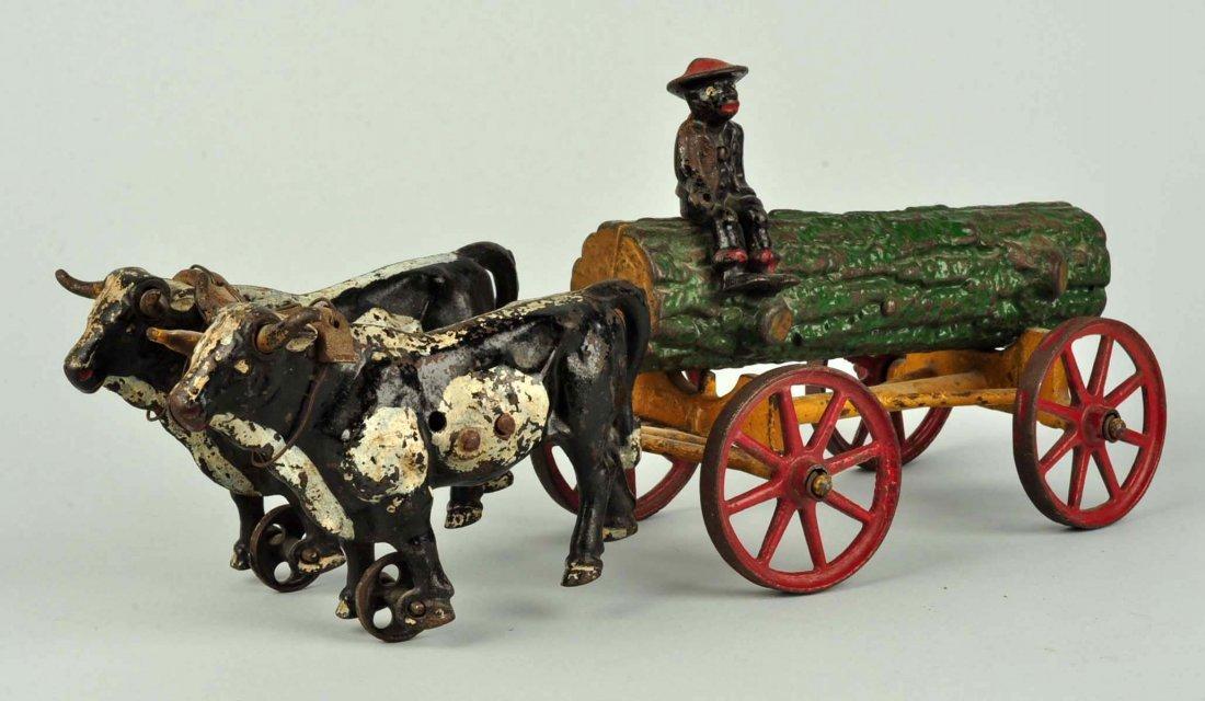Kenton Cast Iron Ox Driven Log Cart.. - 2