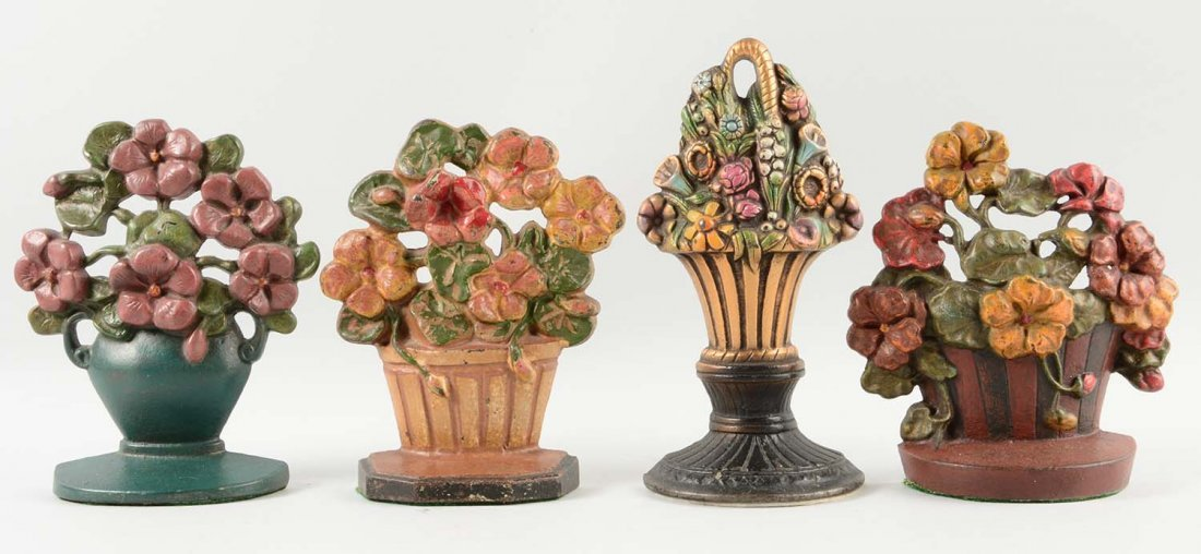 Lot of 4: Cast Iron Assorted Flower Doorstops.