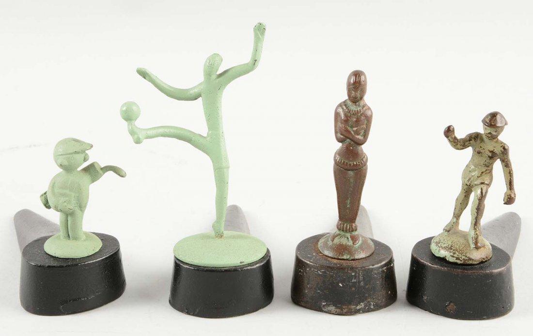 Lot of 4: Cast Iron Assorted Figural Wedge Doorstops.