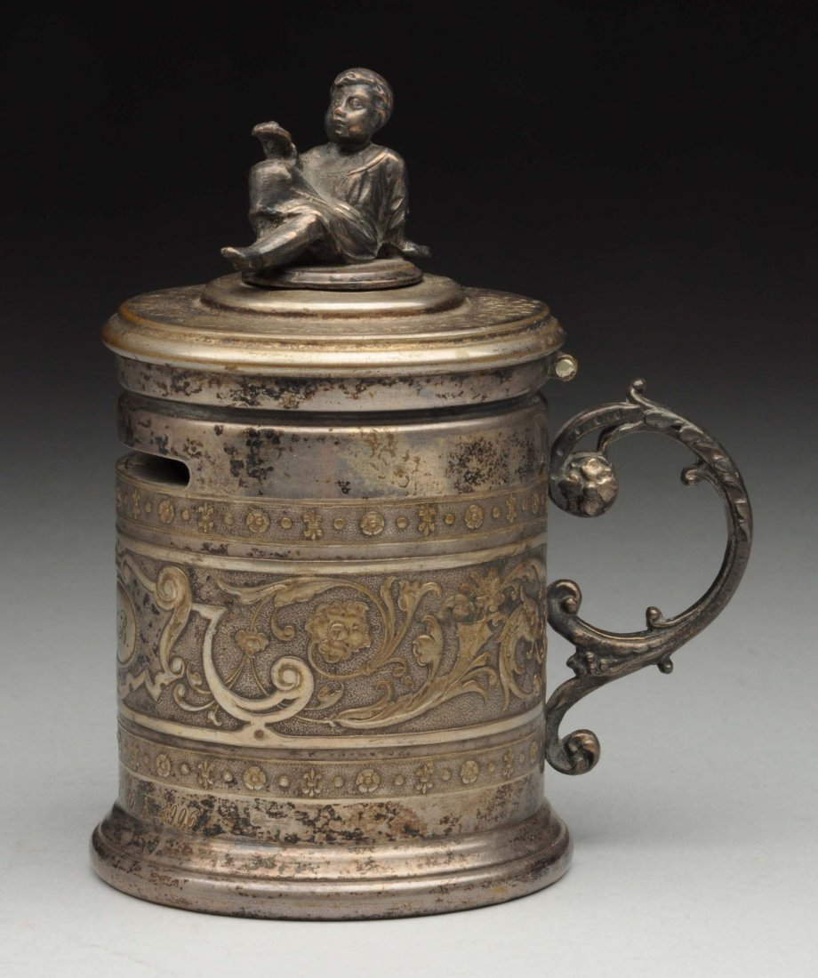 Silver Stein Bank With Lead Figure Of Child On Top