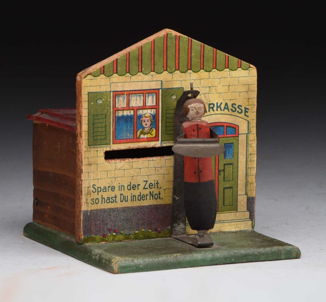 Wood Cottage Mechanical Bank.