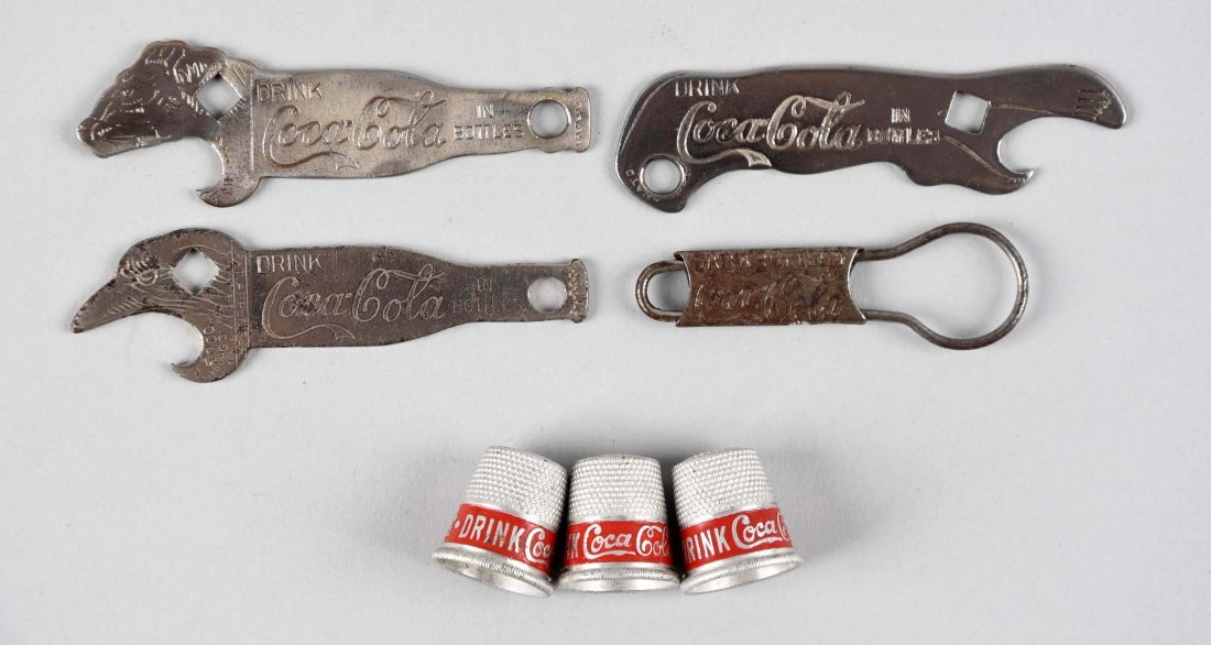 Assorted Early Coca - Cola Bottle Openers & Thimbles.