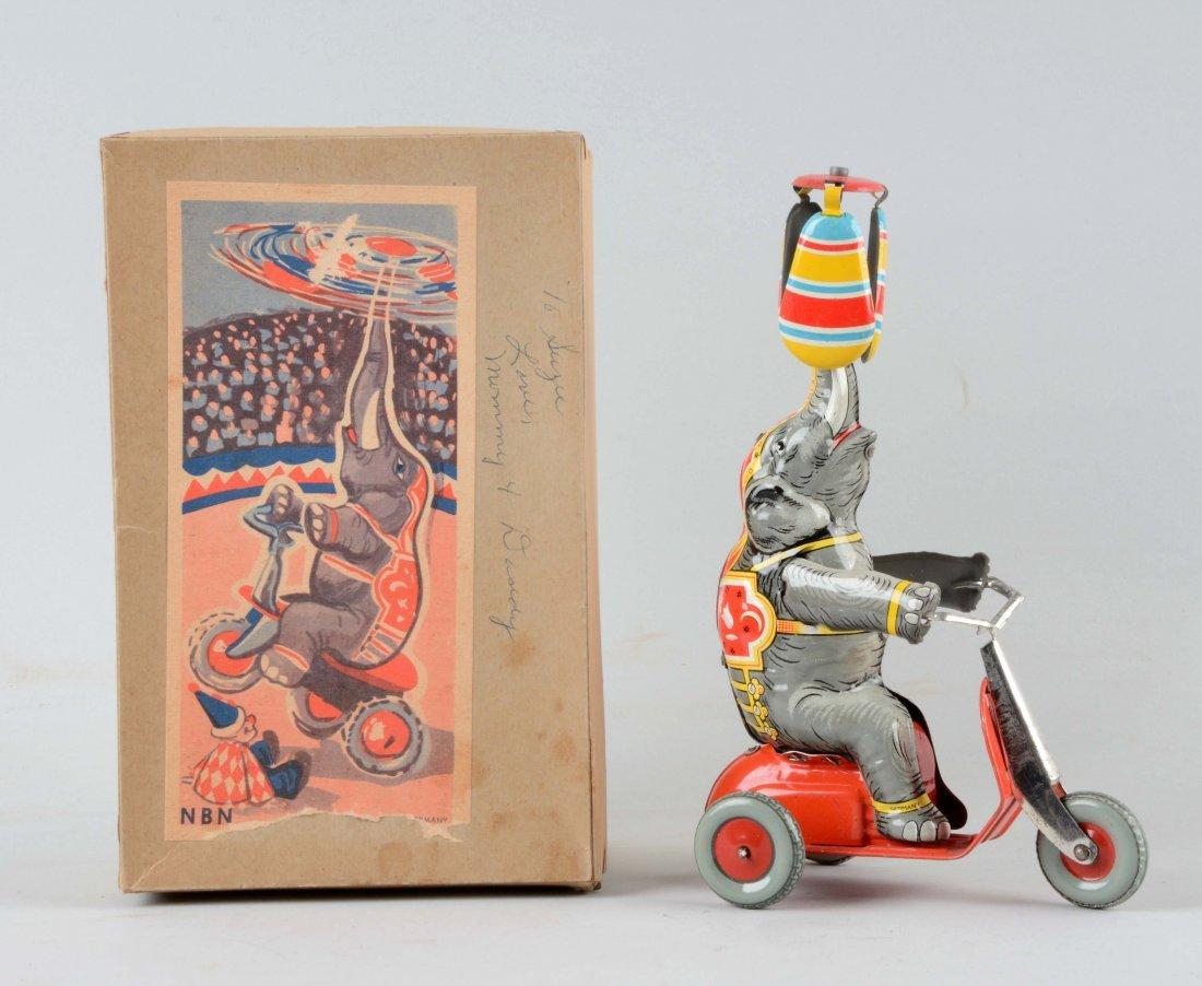 German Tin Litho Wind Up Elephant Tricyclist Toy.