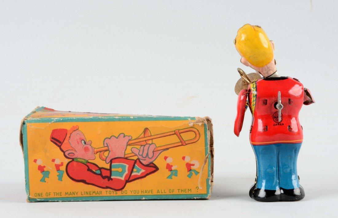 Japanese Tin Litho Wind Up Trombone Player. - 2