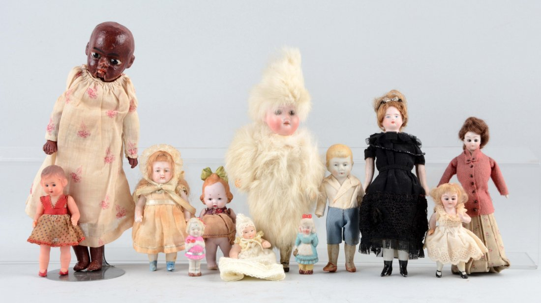 Lot Of 11: Small Bisque Dolls.