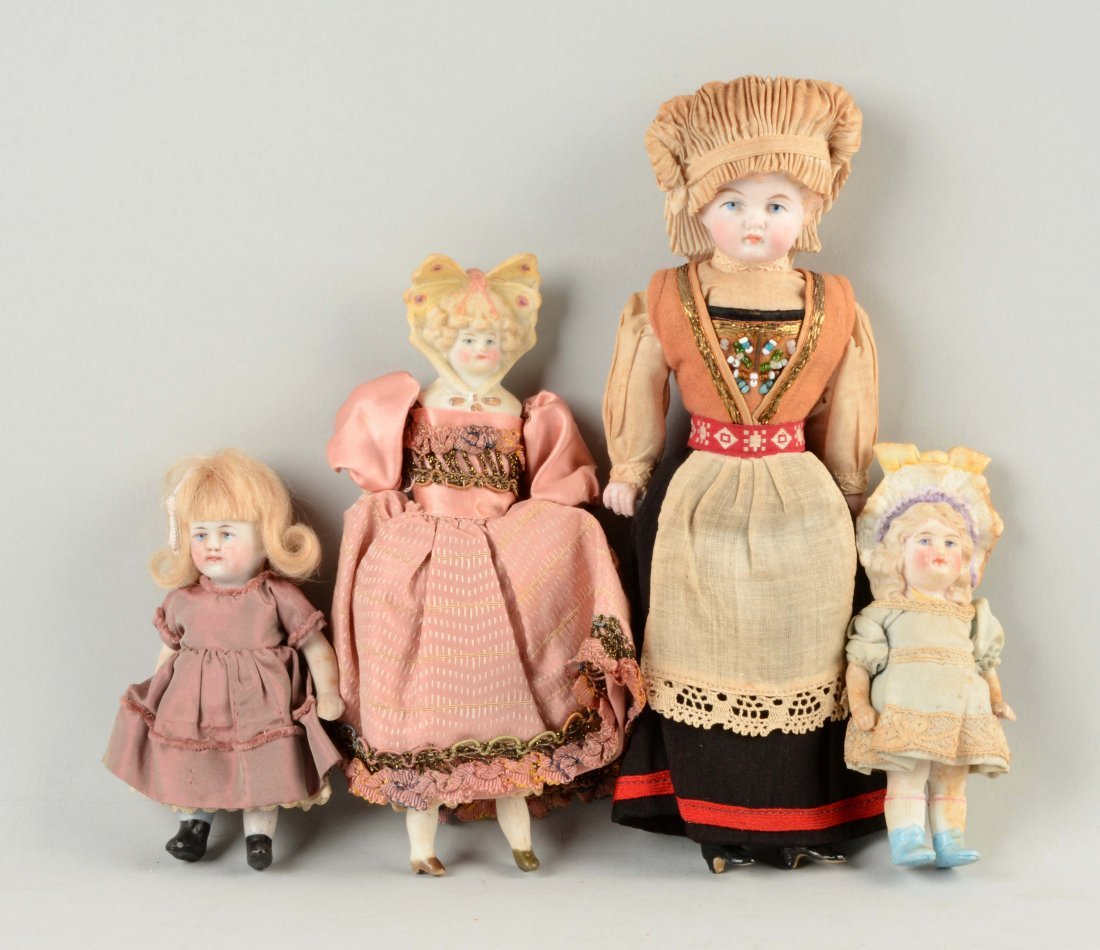Lot of 4: Small Bisque Dolls.
