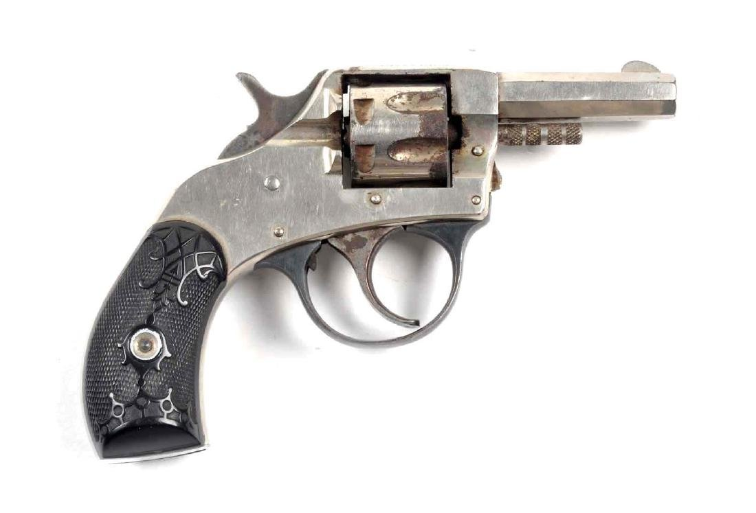 """(C) H&R """"Young American"""" Revolver."""