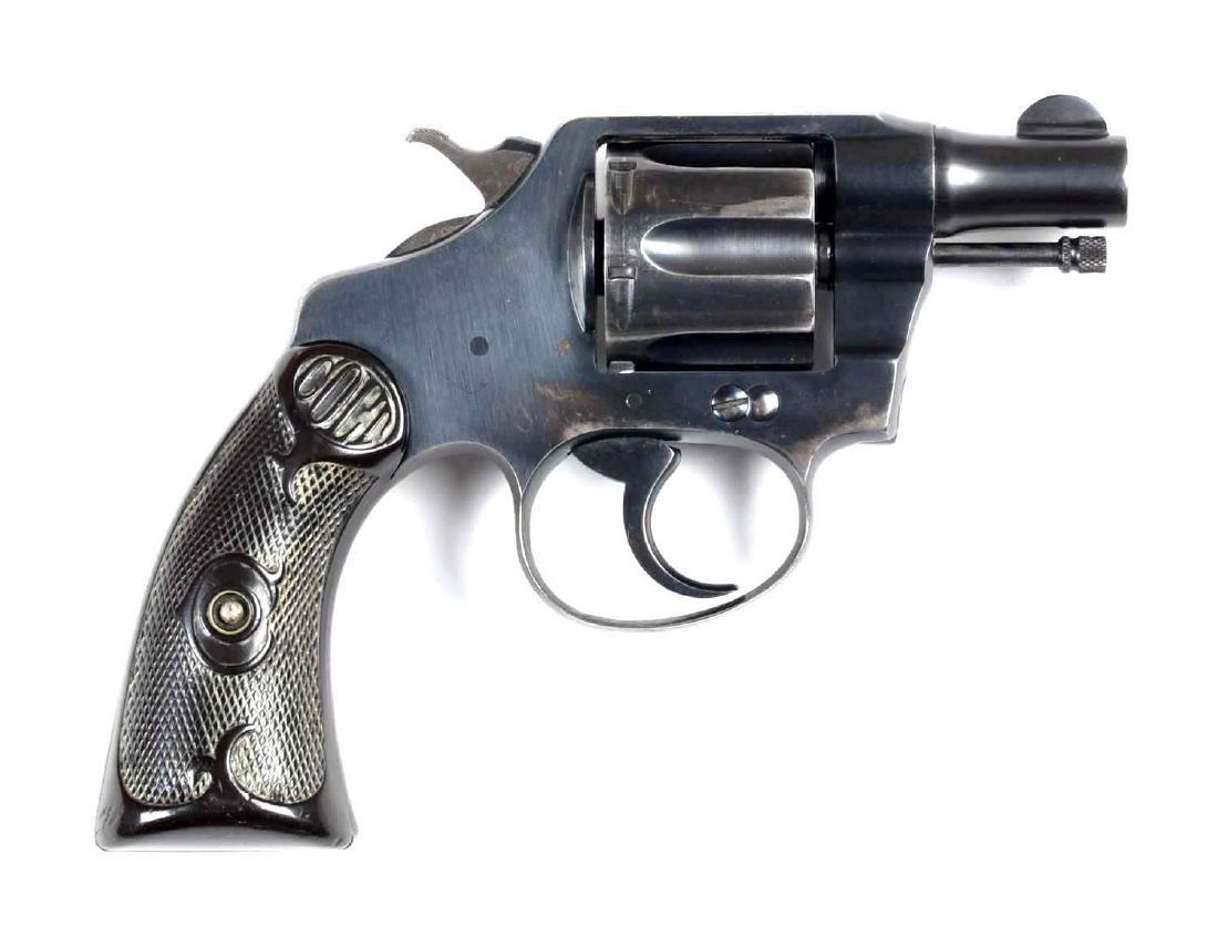 (C) Colt Police Positive Revolver.