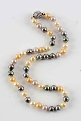 Pearl Necklace w/ Diamond Clasp.