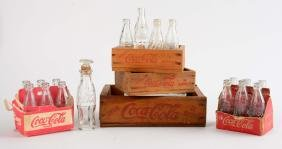 Assorted Glass Coca - Cola Bottles & Wooden Crates.