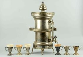 Ornate Silver plated Beverage Dispenser With 6 Cups.