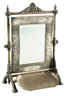 James W. Tufts Silver Plated Mirror.