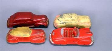 Four vintage Auburn Rubber toy cars