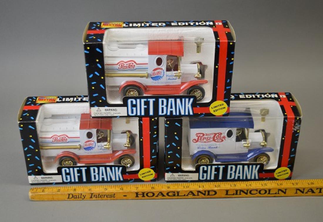 Three Pepsi Cola diecast banks