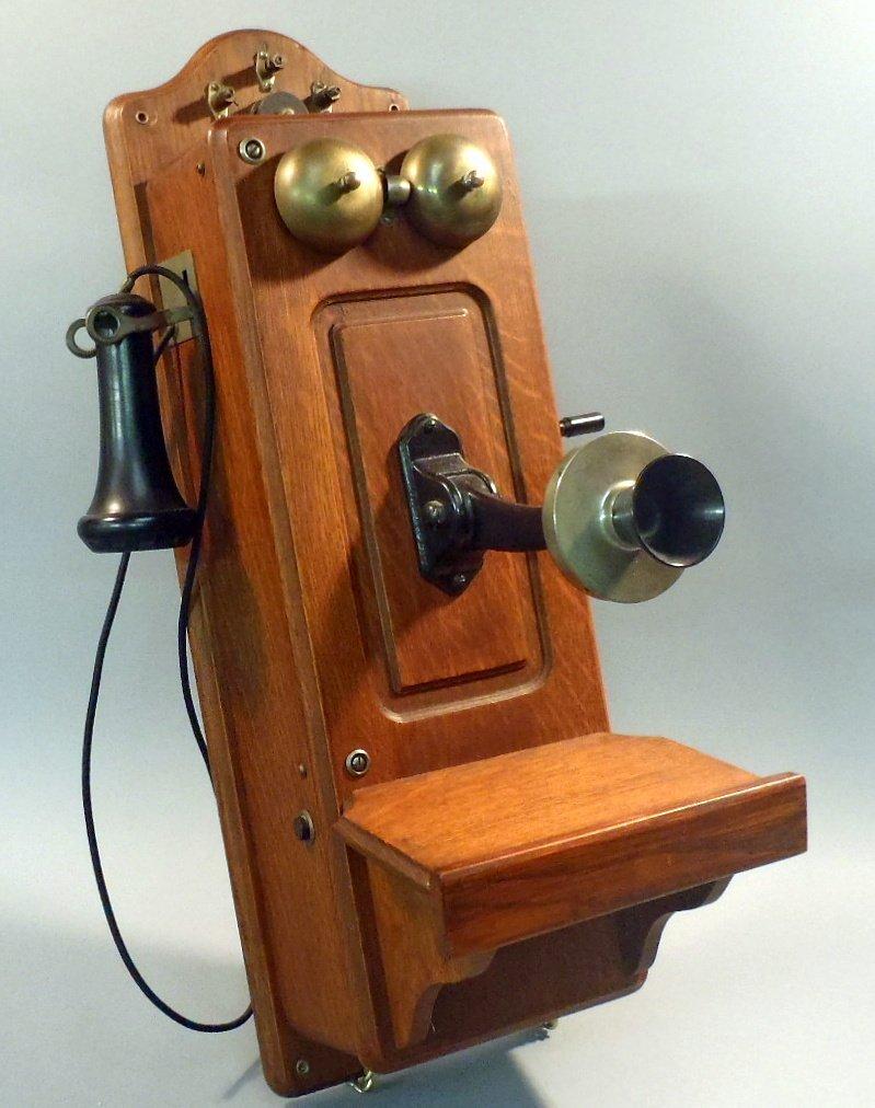 Antique oak hand crank wall phone