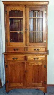 - Antique Golden Oak Stepback Cupboard