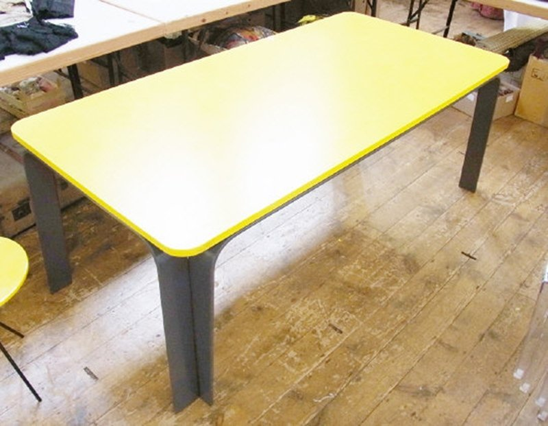 Twentieth century bright yellow dining table, by