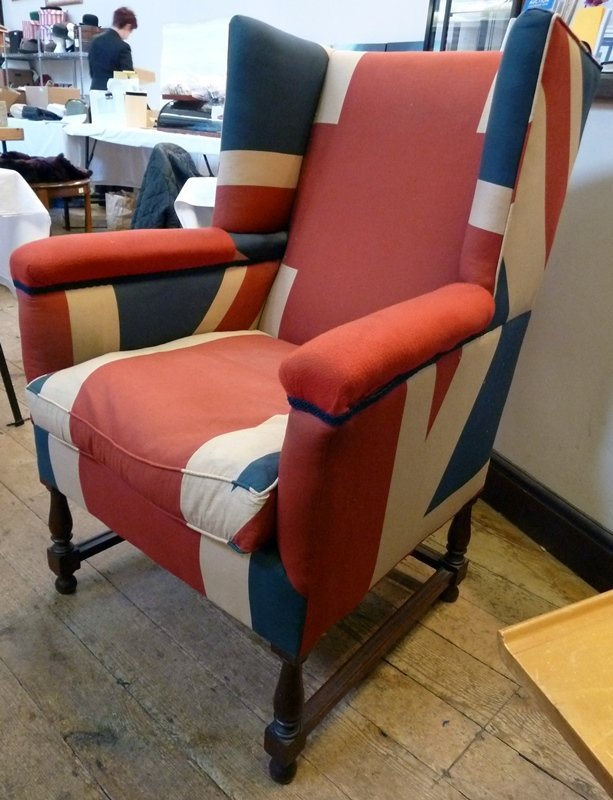 Twentieth century wing armchair, upholstered in Union