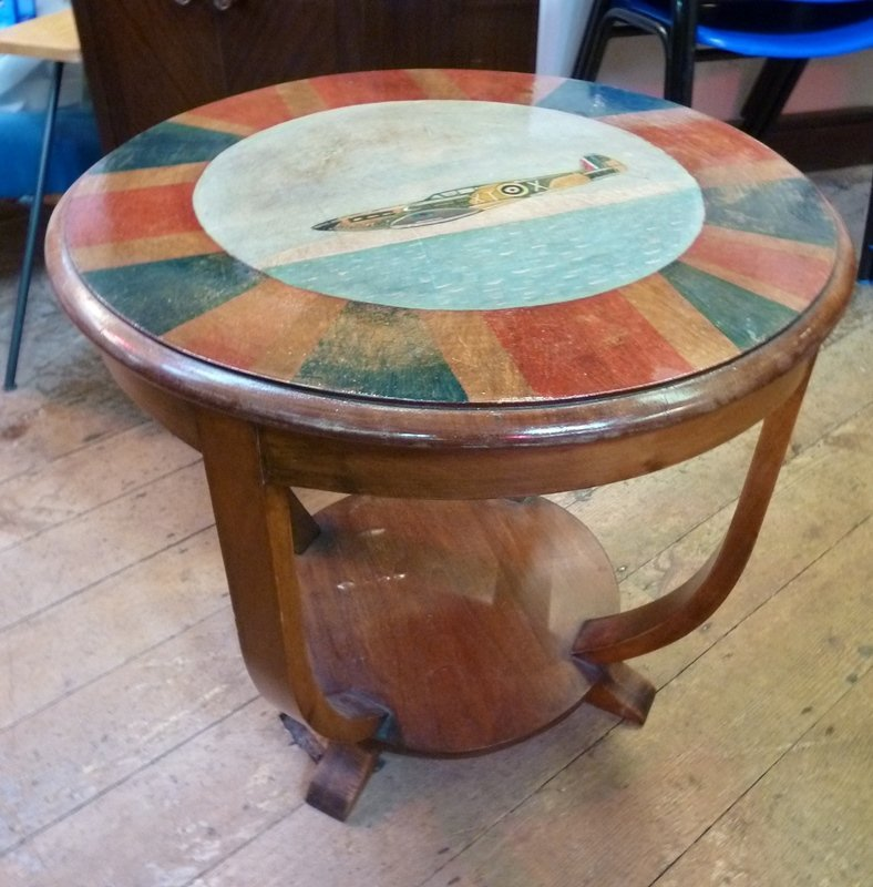 Circular stained two-tier coffee table, painted with