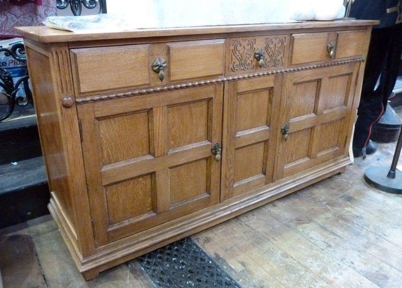 Waring & Gillow Ltd. oak sideboard, three short drawers