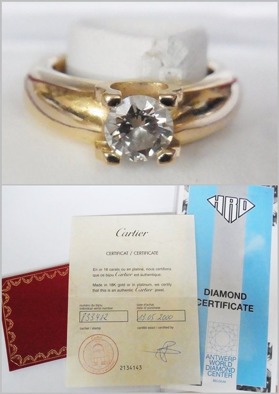 Cartier 18ct yellow gold and solitaire diamond ring,
