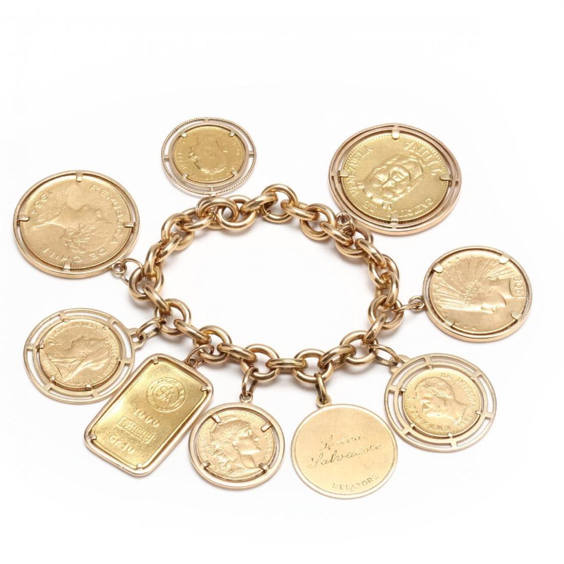 An 18KT Gold Bracelet with a Gold Charm, a Gold Bar,