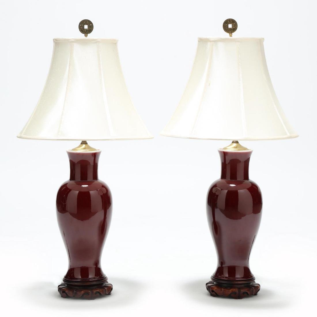 A Pair of Large Chinese Sang de Boeuf Vase Lamps