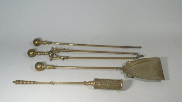 1004: Four Brass Fire Tools, 20th c.,