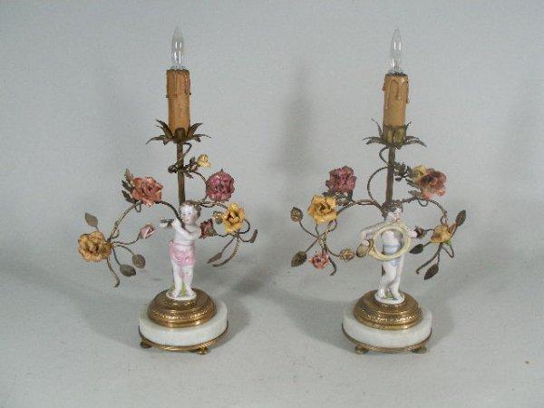 1010: Pair of Porcelain Putti Candlesticks, Continental
