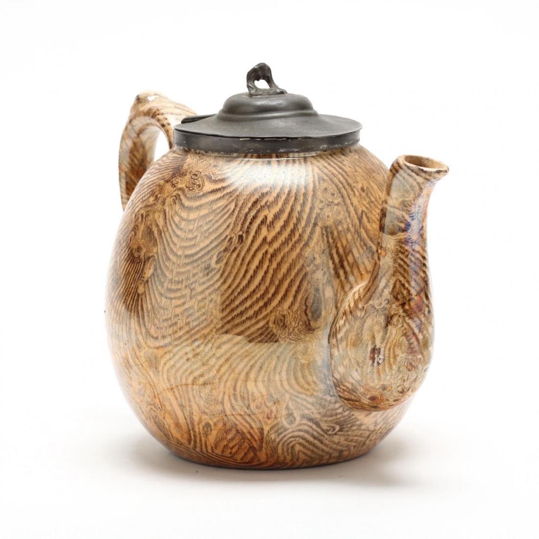 An Antique Faux Bois Staffordshire Teapot