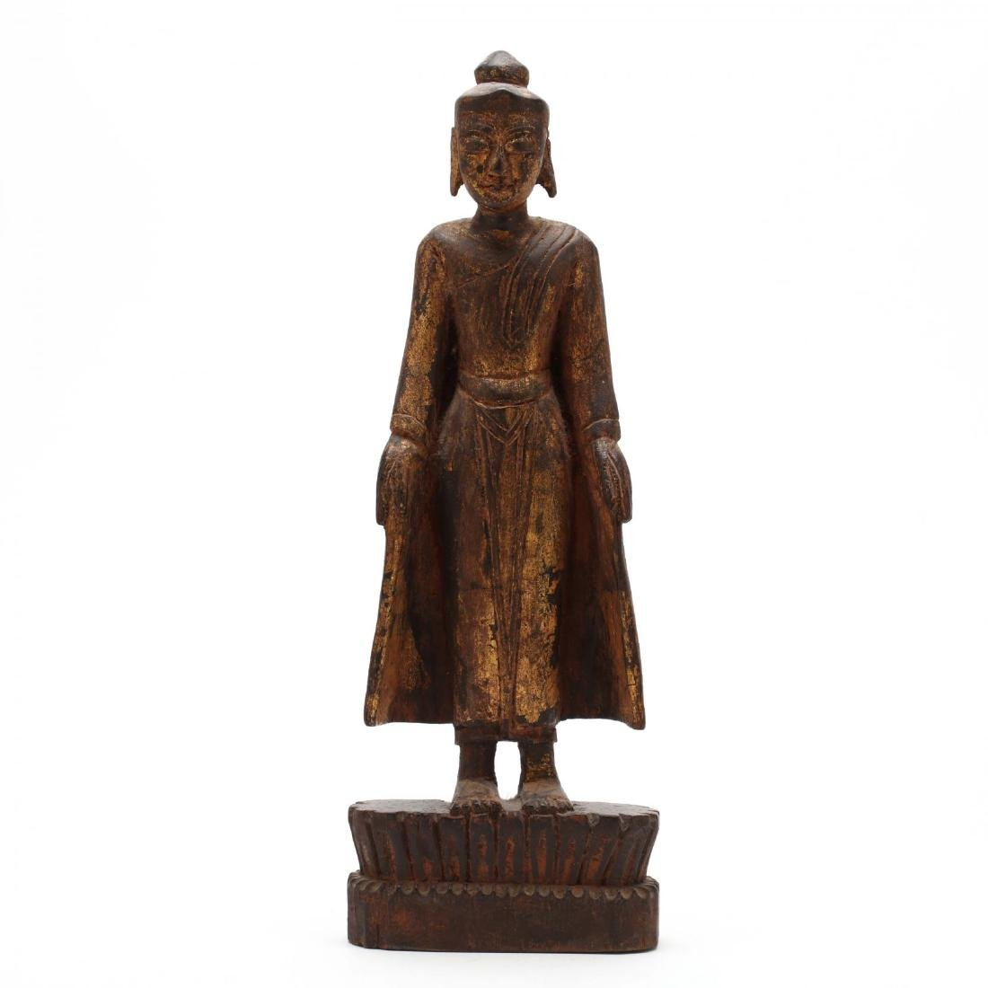 A Carved and Gilt Standing Buddha