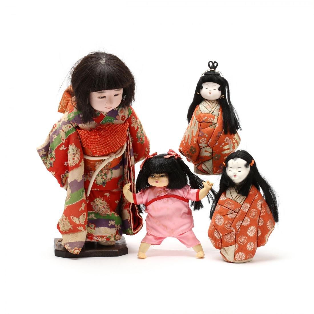 Four Asian Dolls