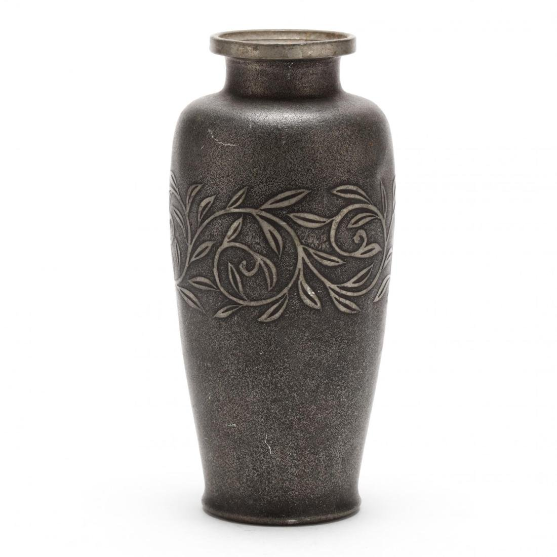An Asian Pewter Vase with Vine Decoration