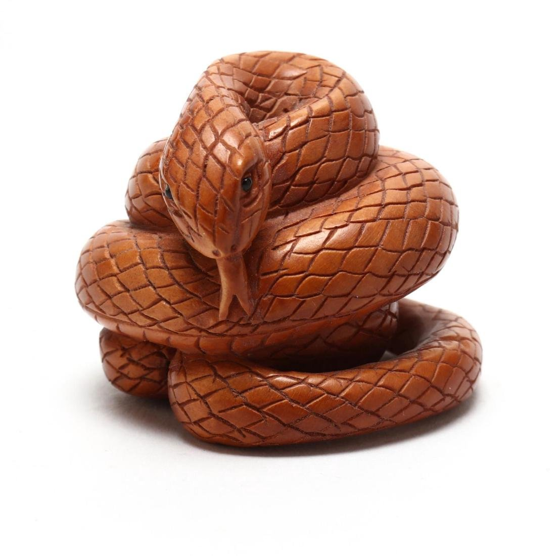 A Japanese Wood Carved Snake Netsuke