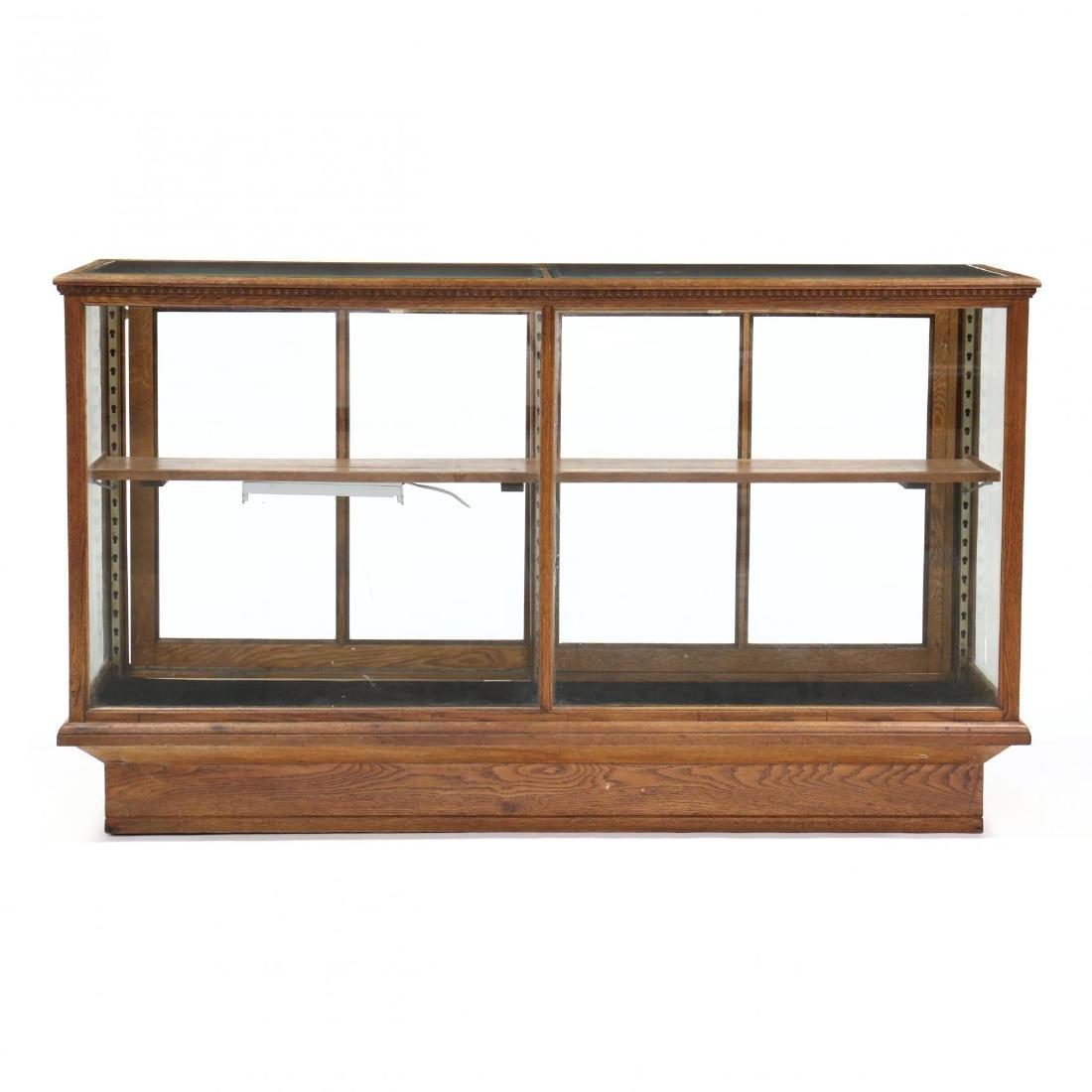 Antique Oak Floor Model Display Case