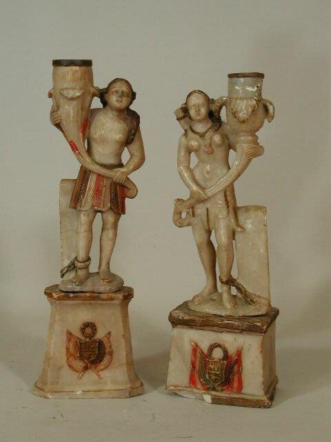 1003: Pair of Carved Huamanga Candlesticks,