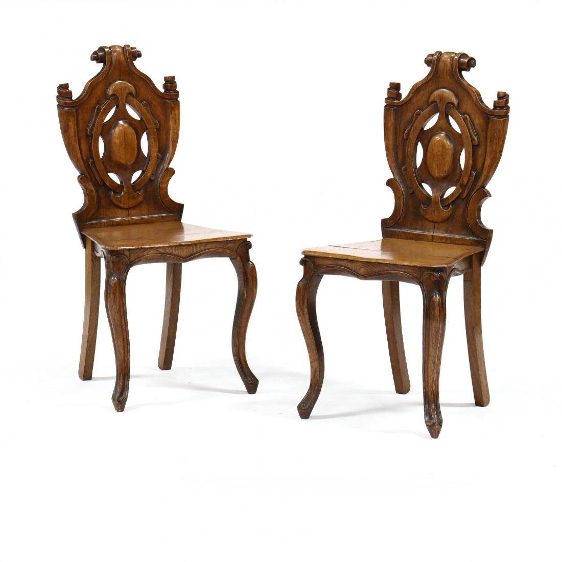 Pair of English Carved Oak Hall Chairs