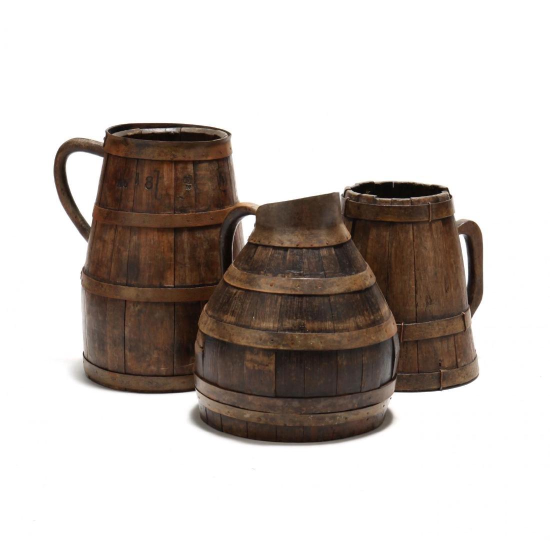 Three Antique Oak Handled Vessels