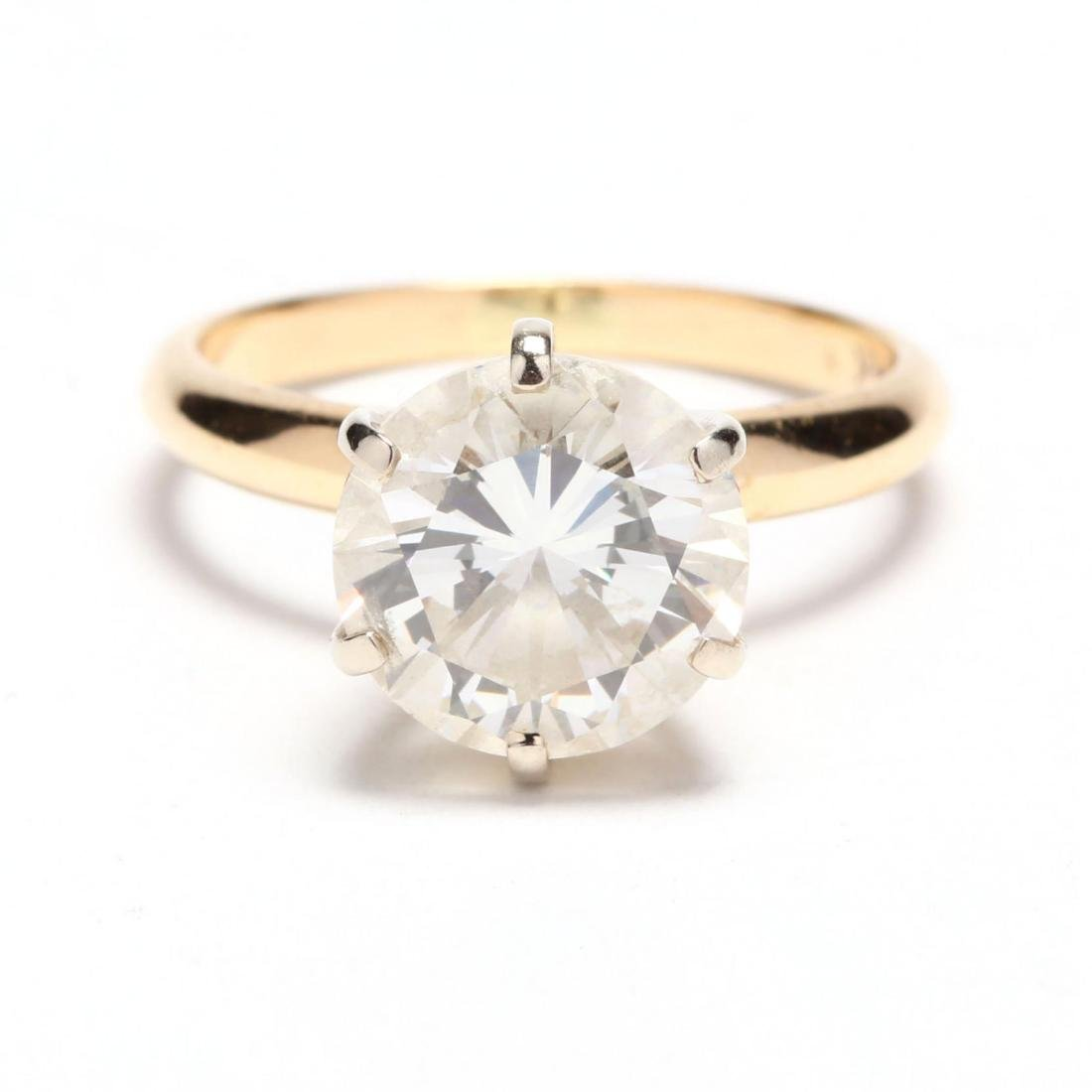 Unmounted Round Brilliant Cut Diamond and 14KT Gold