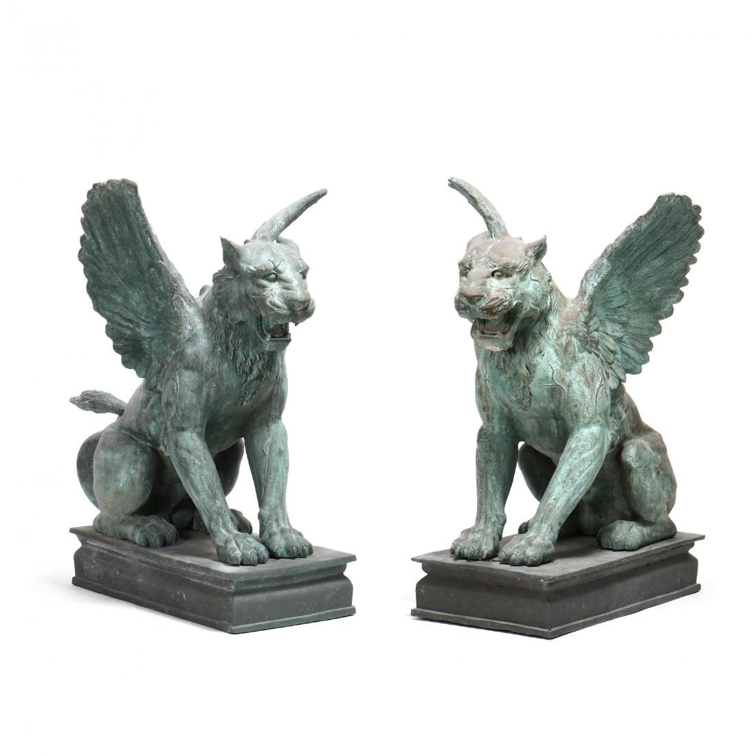 A Pair of Impressive Bronze Winged Lions