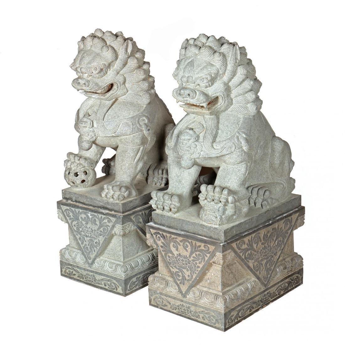 A Pair of Monumental Carved Granite Foo Lions