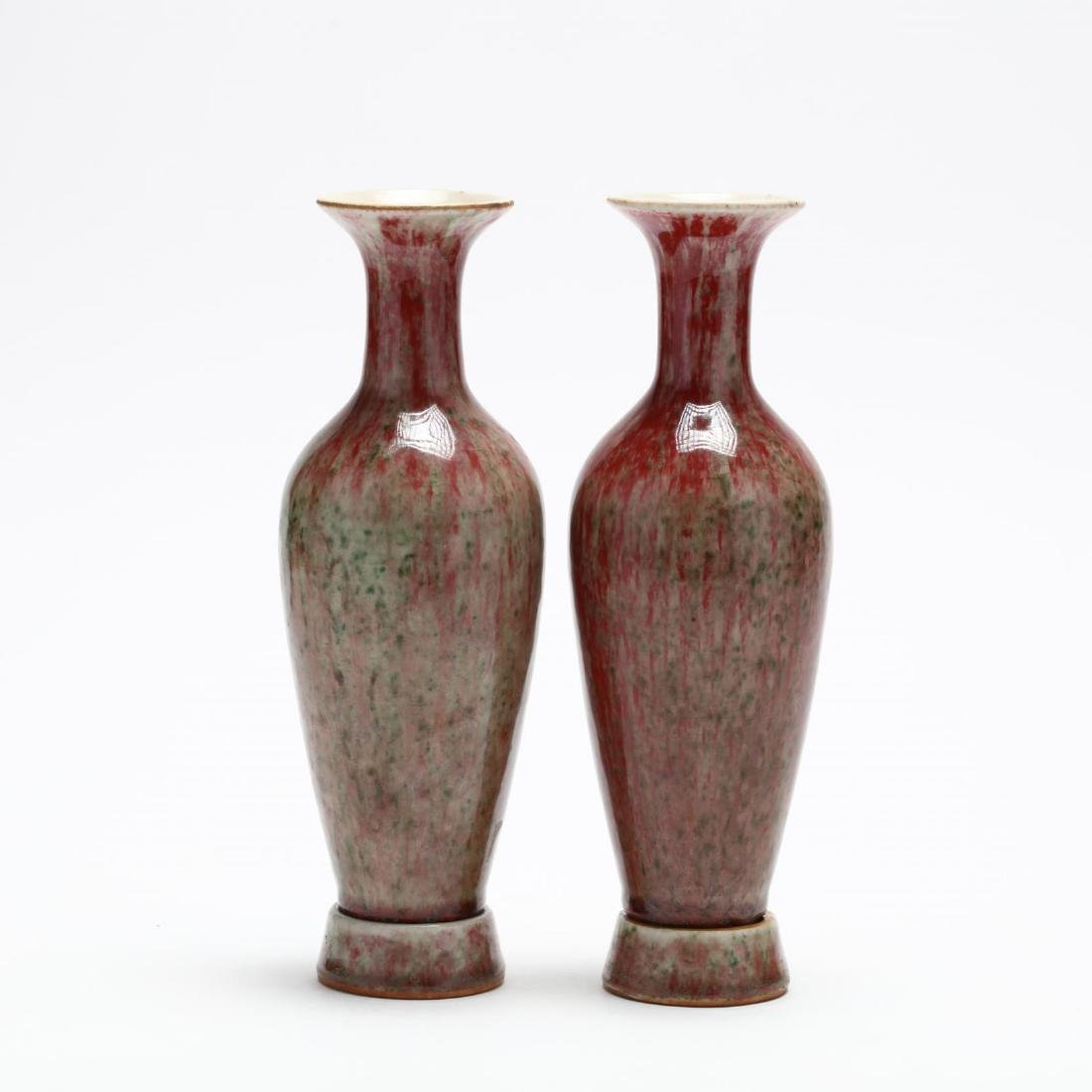 A Pair of Chinese Porcelain Peach Bloom Vases with