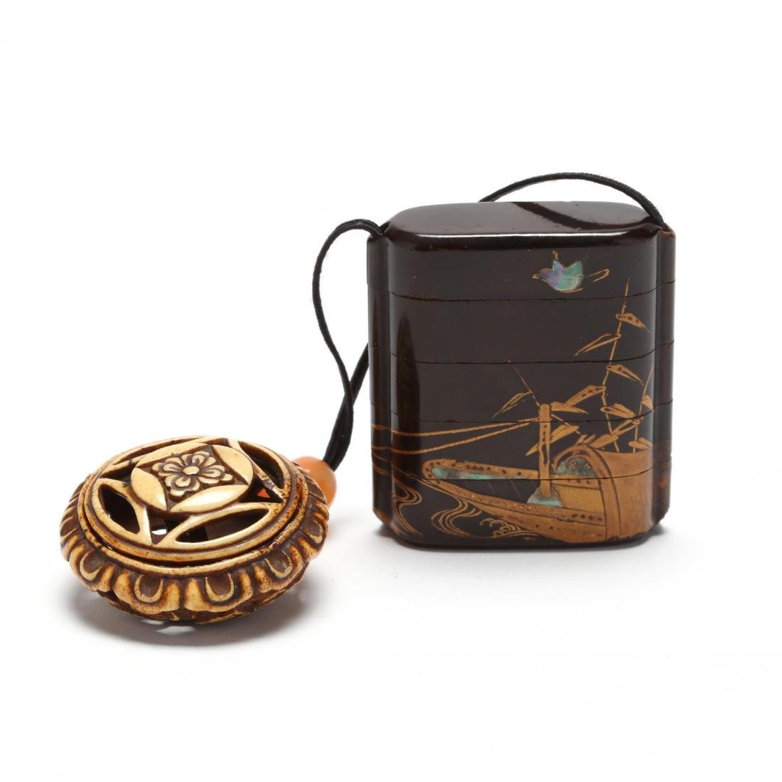 A Japanese Four Case Inro with Pierced Netsuke