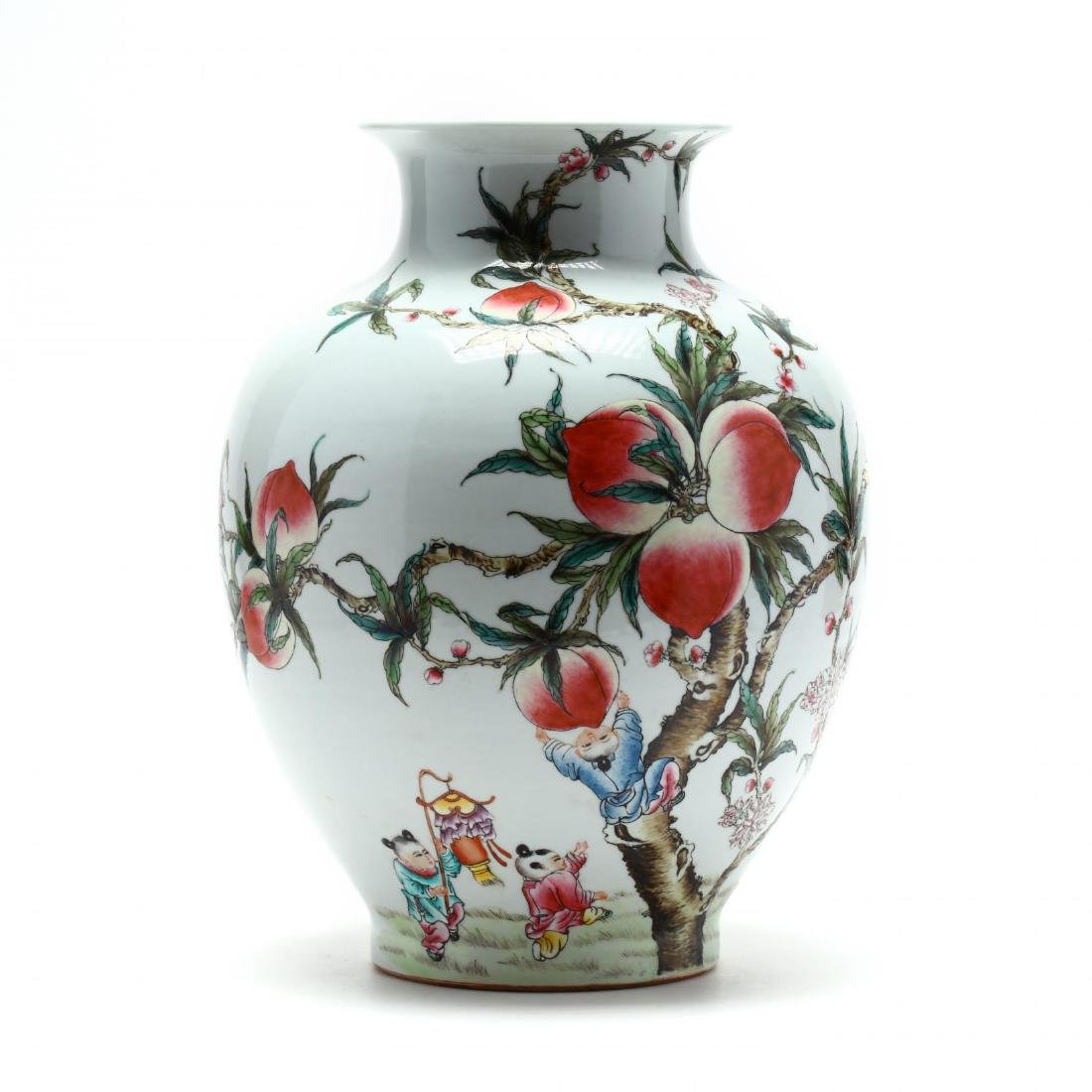 A Chinese Porcelain Vase with Nine Peaches
