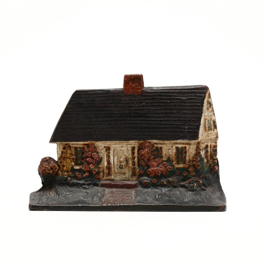 Cape Cod  Cast Iron Cottage Doorstop