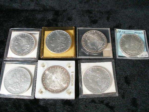 1033: Seven Choice Morgan Silver Dollars,
